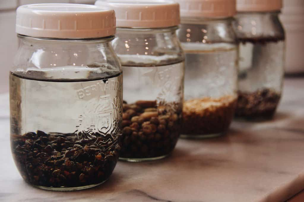soaking seeds in mason jars for growing sprouts at home