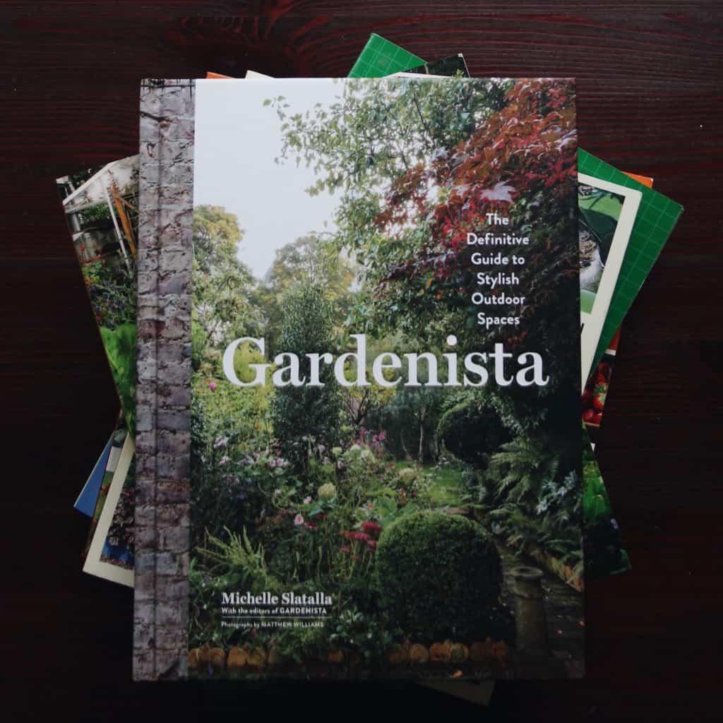 Best Gardening Books - Stack of garden books on table