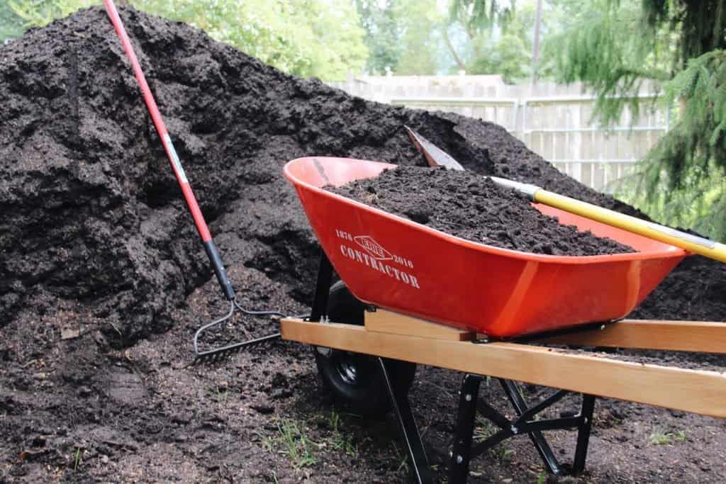 Topsoil in Wheelbarrow | Home for the Harvest Gardening Blog