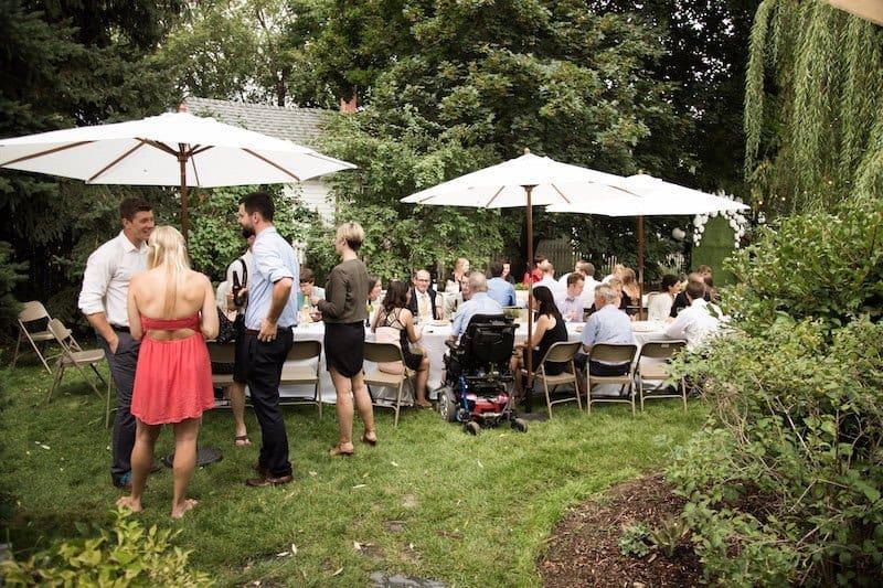 dinner seating for a backyard wedding reception in a garden