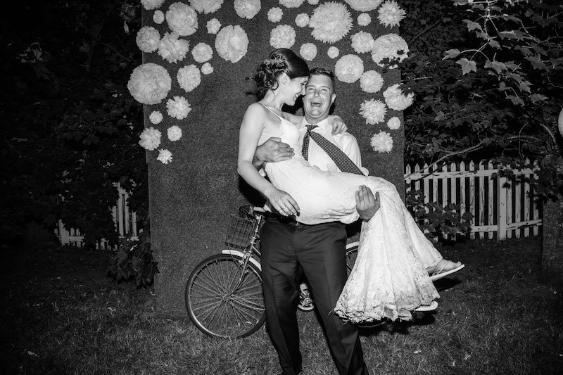 garden wedding photo booth backdrop with white flowers and antique bike