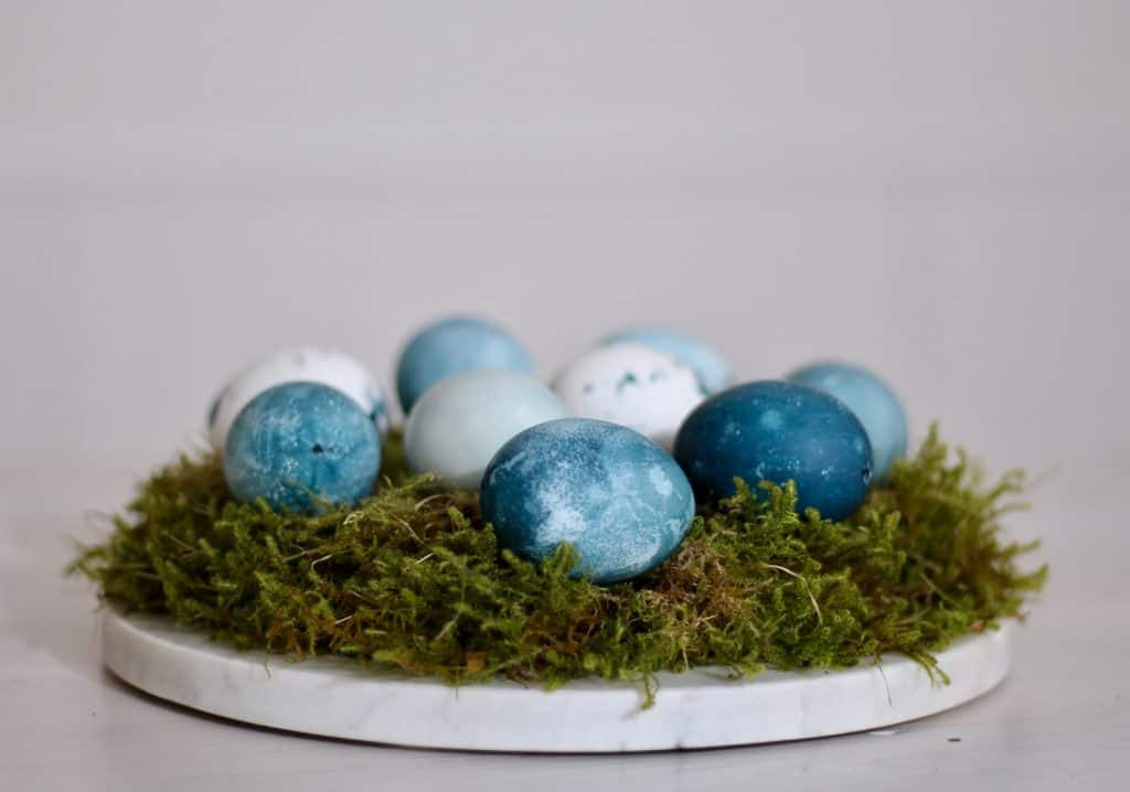 Live moss in a centrepiece with blue easter eggs