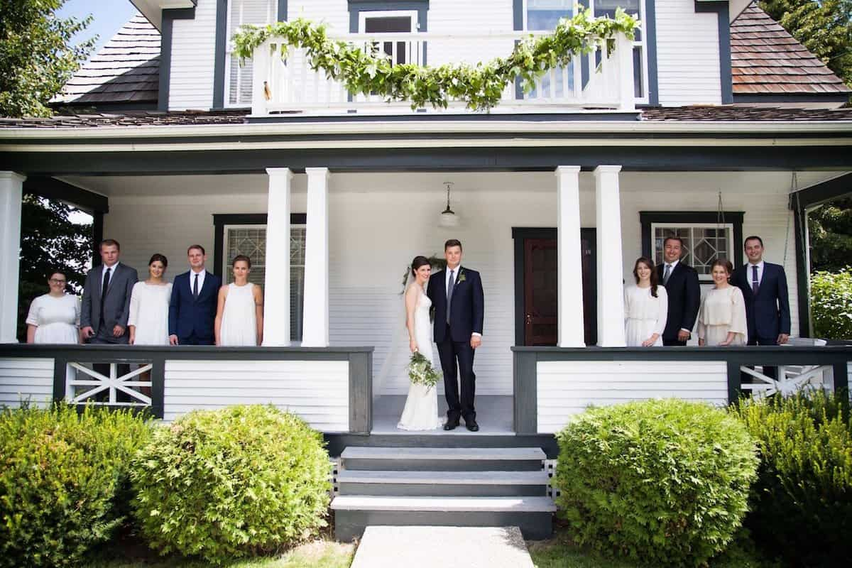 simple backyard wedding ceremony and reception showing wedding party at home on porch