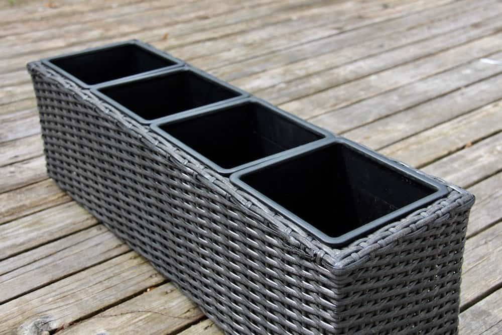 black herb garden container with four separate herb garden planter compartments