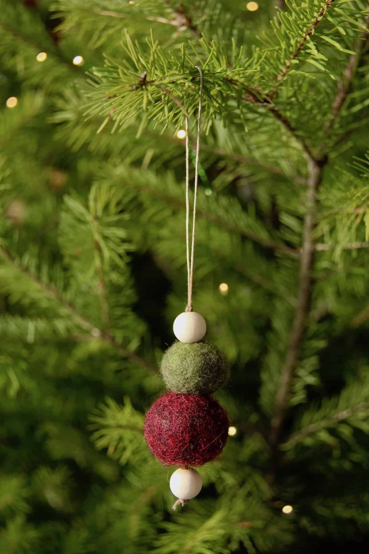Learn how to make felt ornaments with this easy-to-follow Christmas craft tutorial! These felted ornaments are perfect for a rustic farmhouse Christmas! #rusticChristmas #handmadeChristmas #feltedChristmas #Christmasfelting