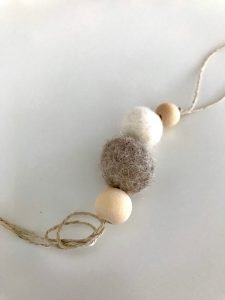 Learn how to make felt ornaments with this easy-to-follow Christmas craft tutorial! These felted ornaments are perfect for minimalist or Scandinavian Christmas decor. #Scandinavian #Minimalist #Christmas #ScandinavianOrnaments