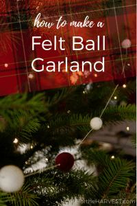 SO cute! Here's how to make a felt pom pom garland for Christmas. This felt garland tutorial is a perfect Christmas craft to make a modern garland for your Christmas tree or holiday mantle. Make this felt ball garland this year! #pompomgarland #feltballgarland #woolpompomgarland #feltgarland