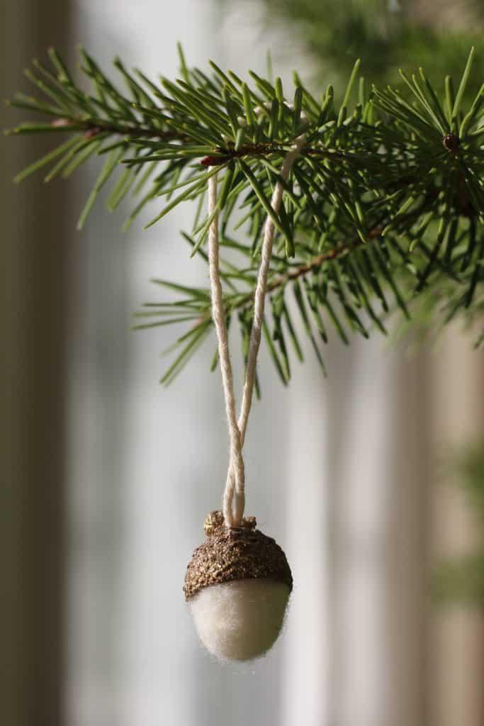 glittery gold and white wool felt acorn ornament on christmas tree