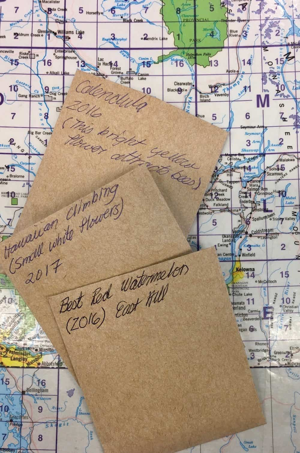 seed collection packets at a local seed library on top of area map