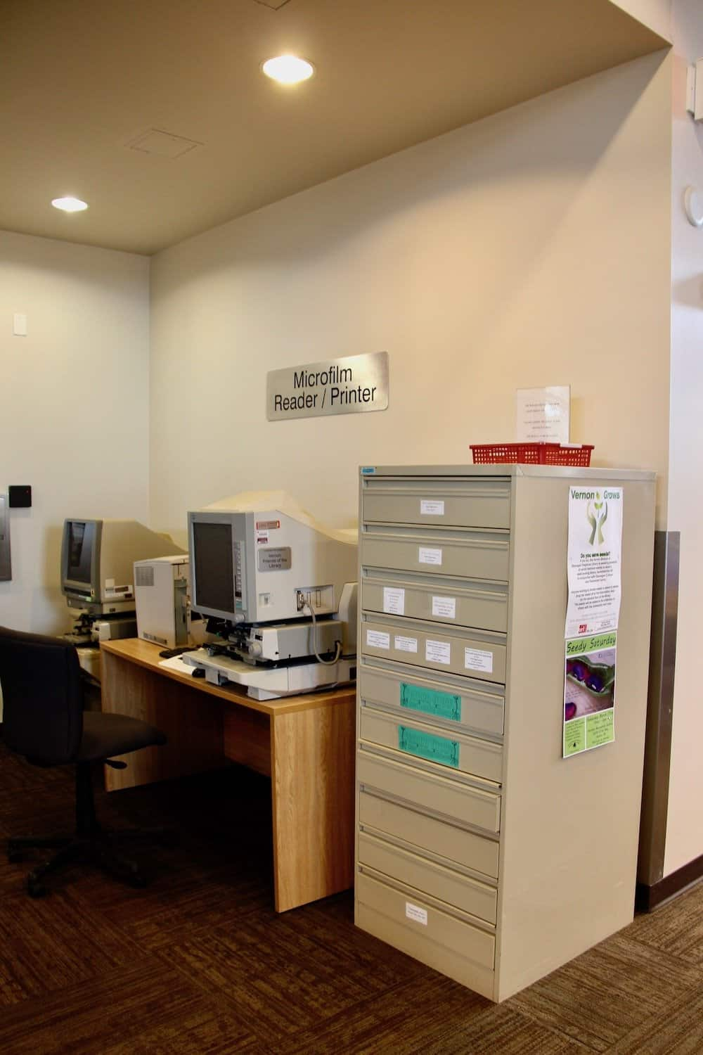 filing cabinet at public seed library with computers and labelled seed collection