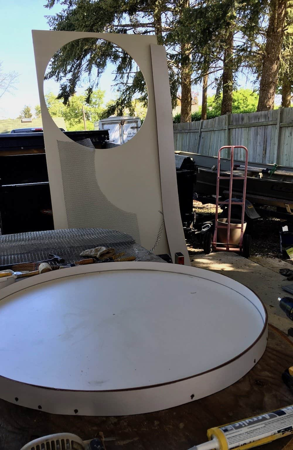 Concrete form for a round dining table on outdoor workbench