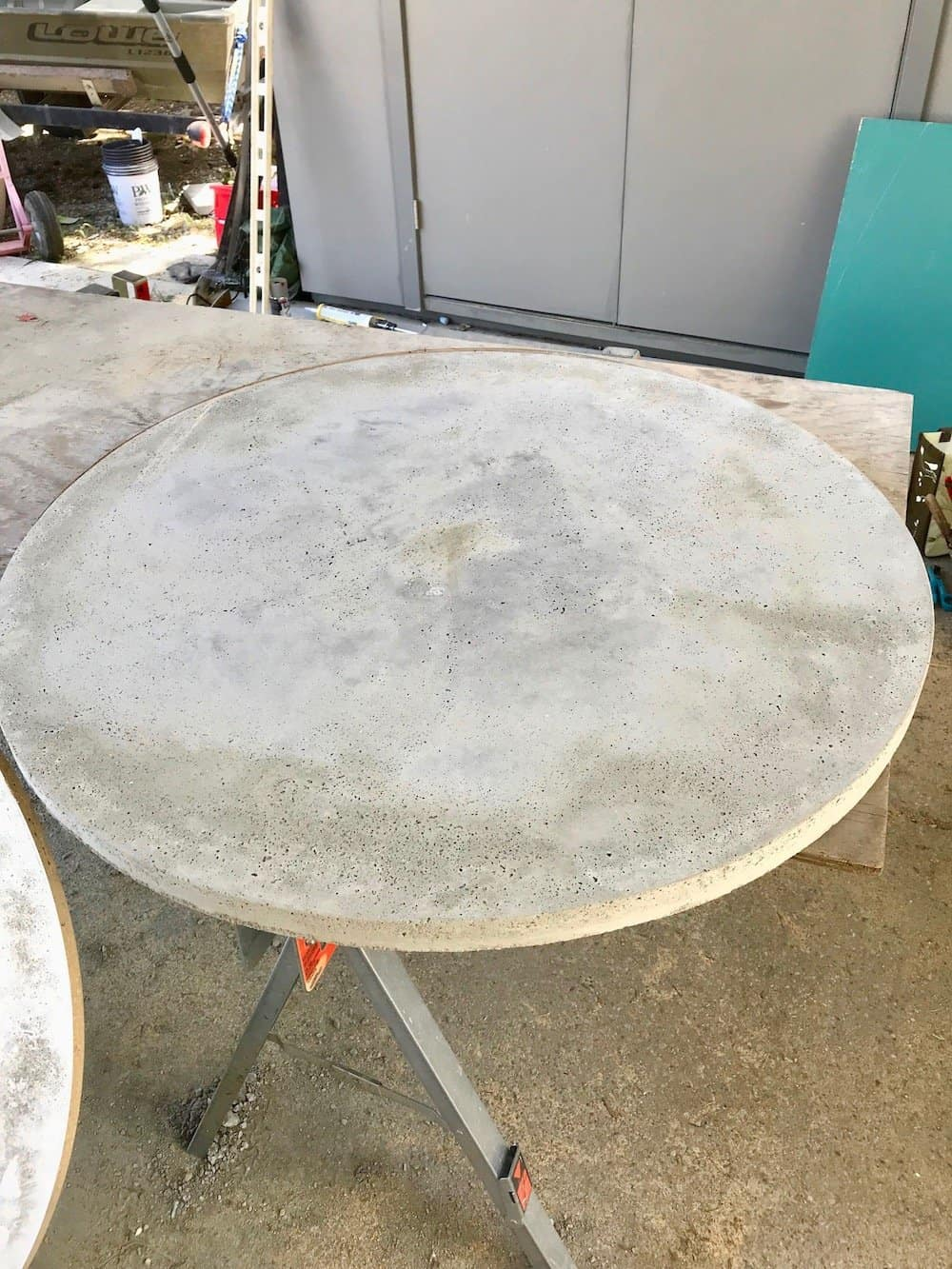 Round dining table top made of concrete on a workbench