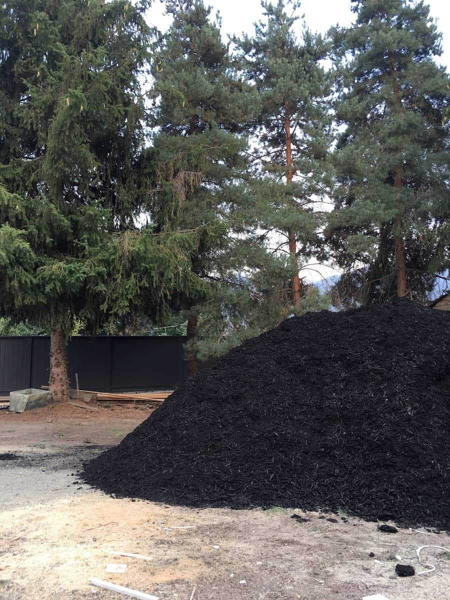 Bulk Mulch Delivery of Black Mulch in Backyard