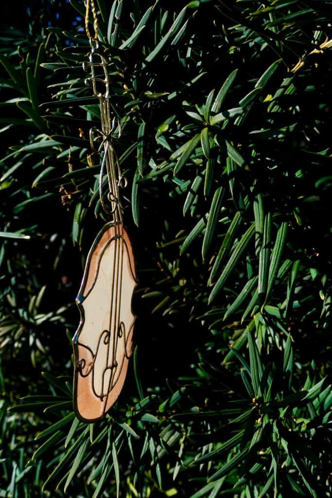 Stained Glass Violin Tree Ornament on Dark Green Christmas Tree