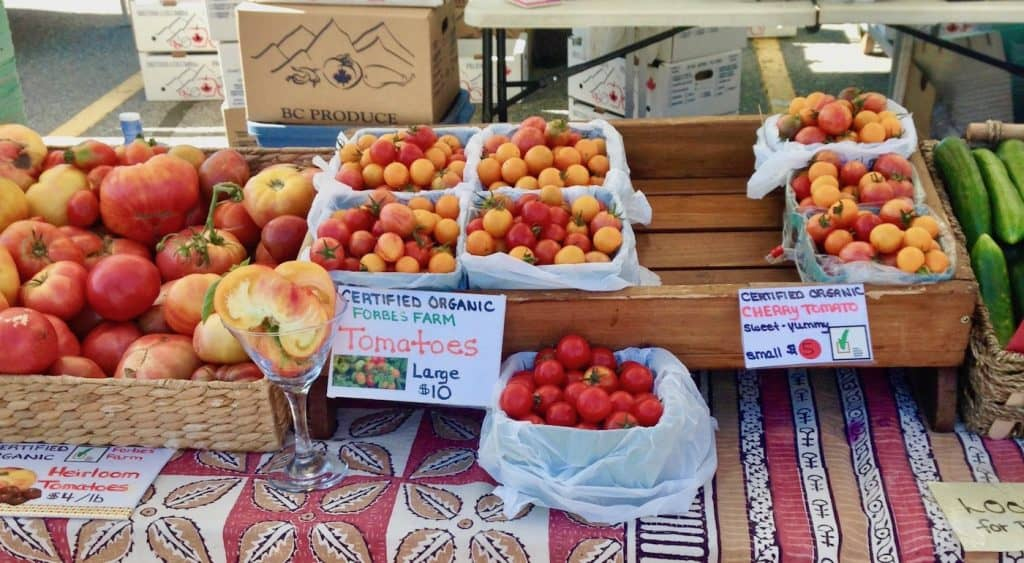 Organic Heirloom Tomatoes at a Farm Stand