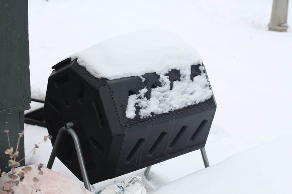 Compost Tumbler in Winter Covered with Snow
