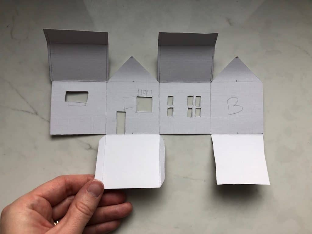 Folding together the 3d paper house ornament