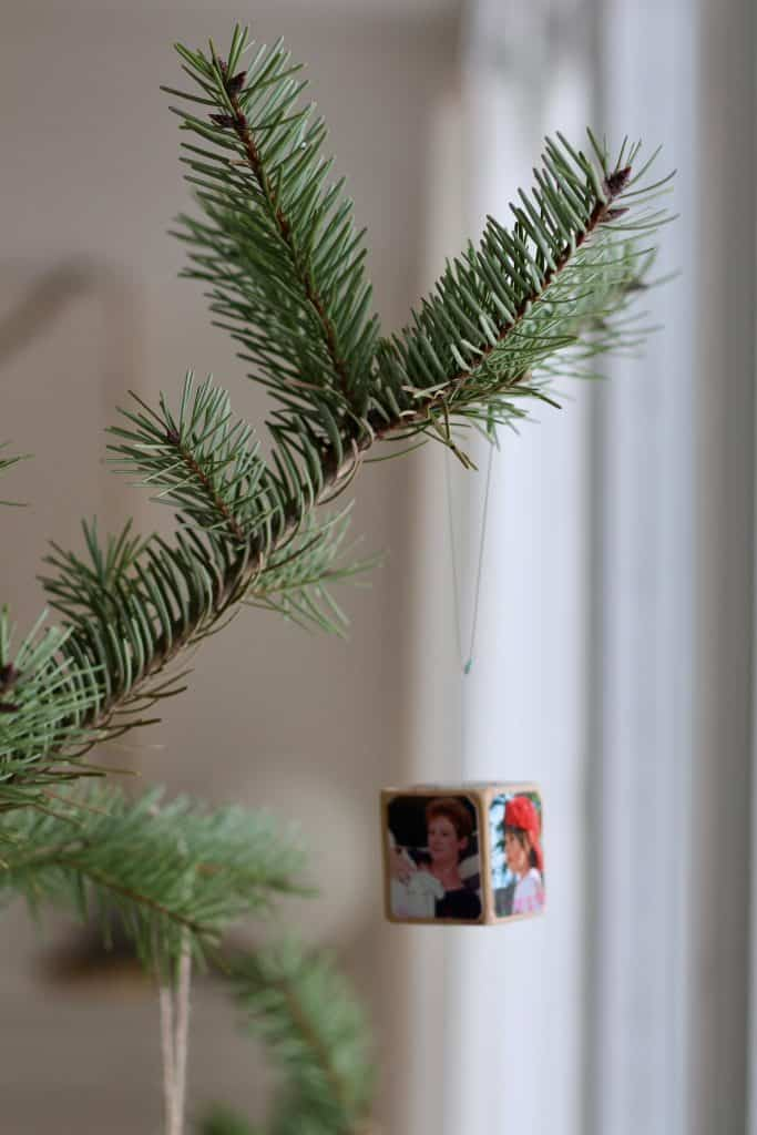 The original photo cube ornament on the Christmas tree - DIY wooden block memento holiday decor