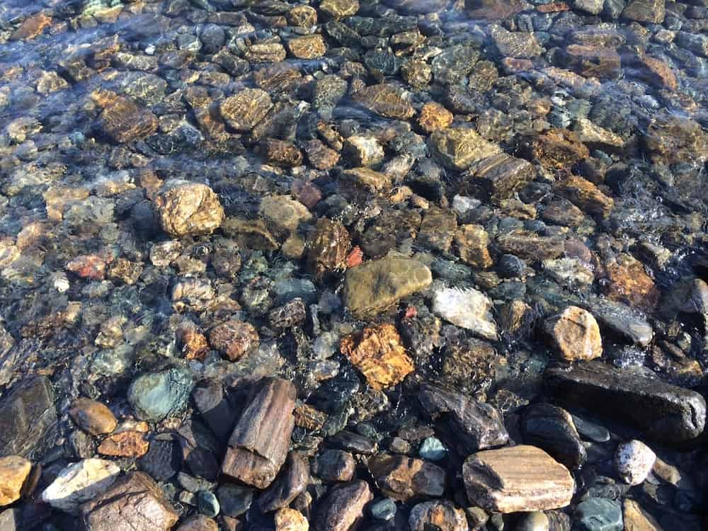 Pea gravel forms in streambeds where water weathers the edges until they are smooth
