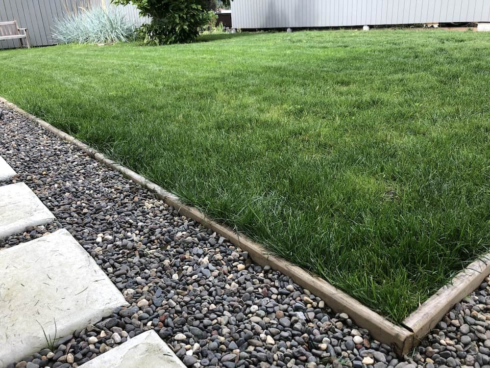 Pea gravel often needs to be contained with an edging material, like this rot-resistant cedar