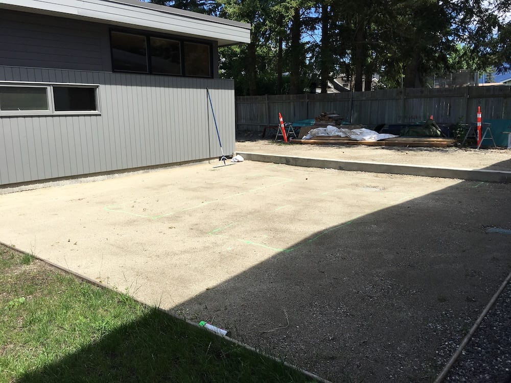building a pea gravel patio - photo of prepared structural base of crushed rock compacted