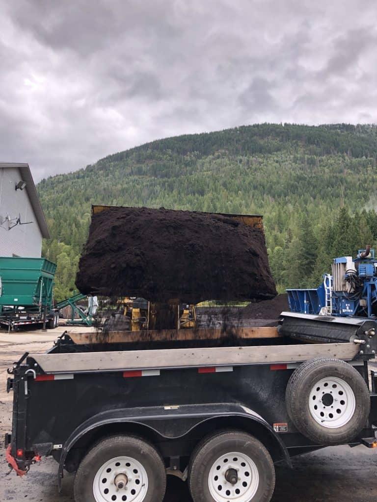 Dark Brown Landscape Mulch Being Loaded into Utility Trailer