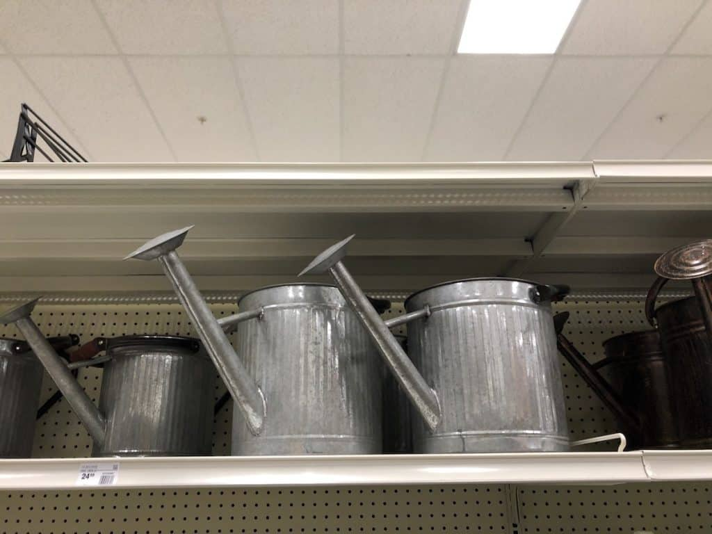 Metal Watering Cans on Store Shelf