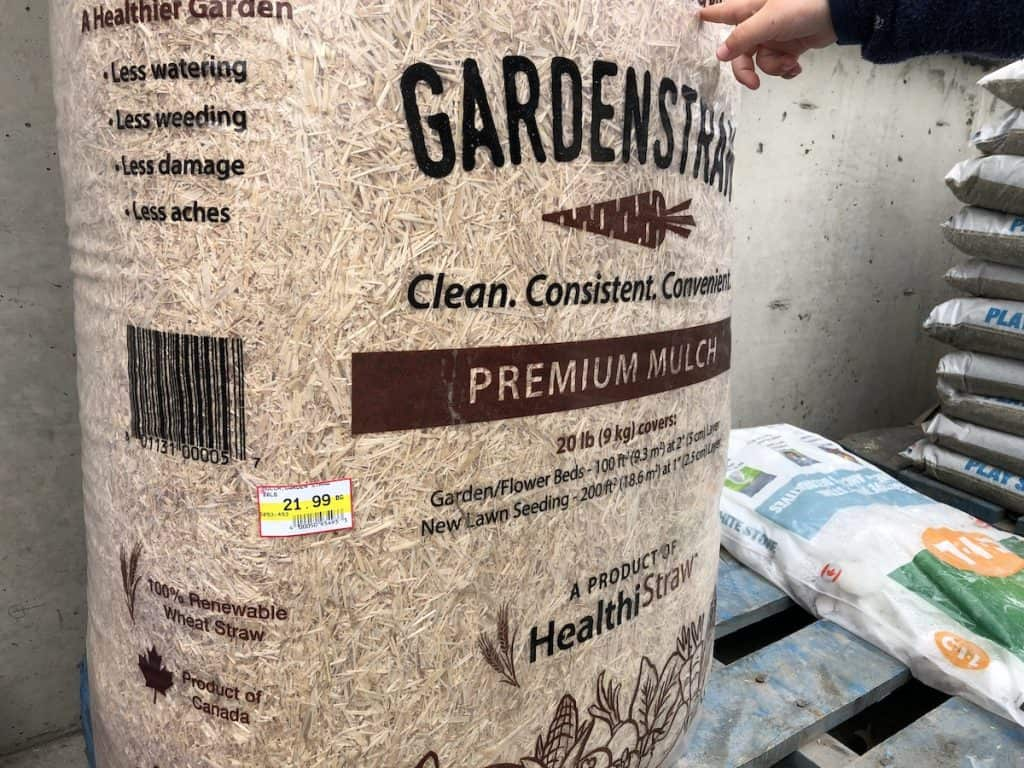 straw mulch for strawberries in a bag at garden center