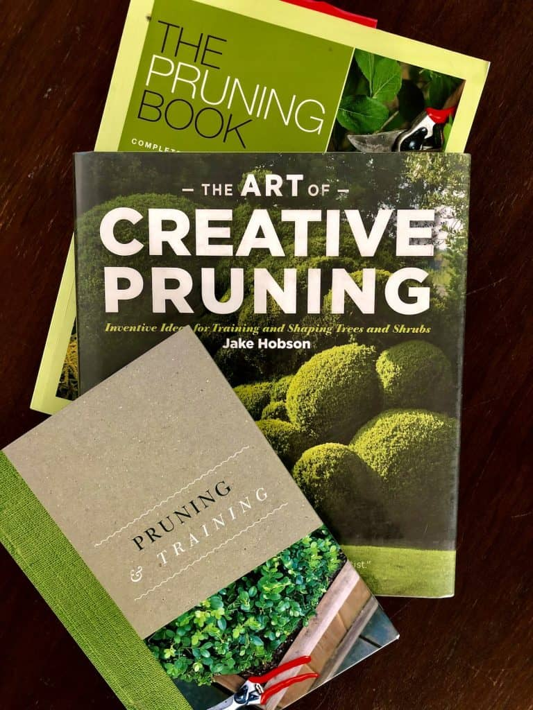 books about pruning on wooden coffee table