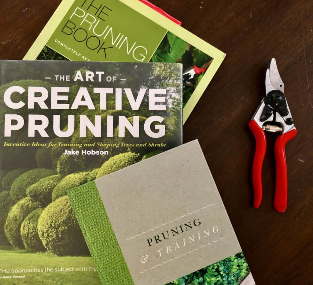 books about pruning plants - with red pruning shears