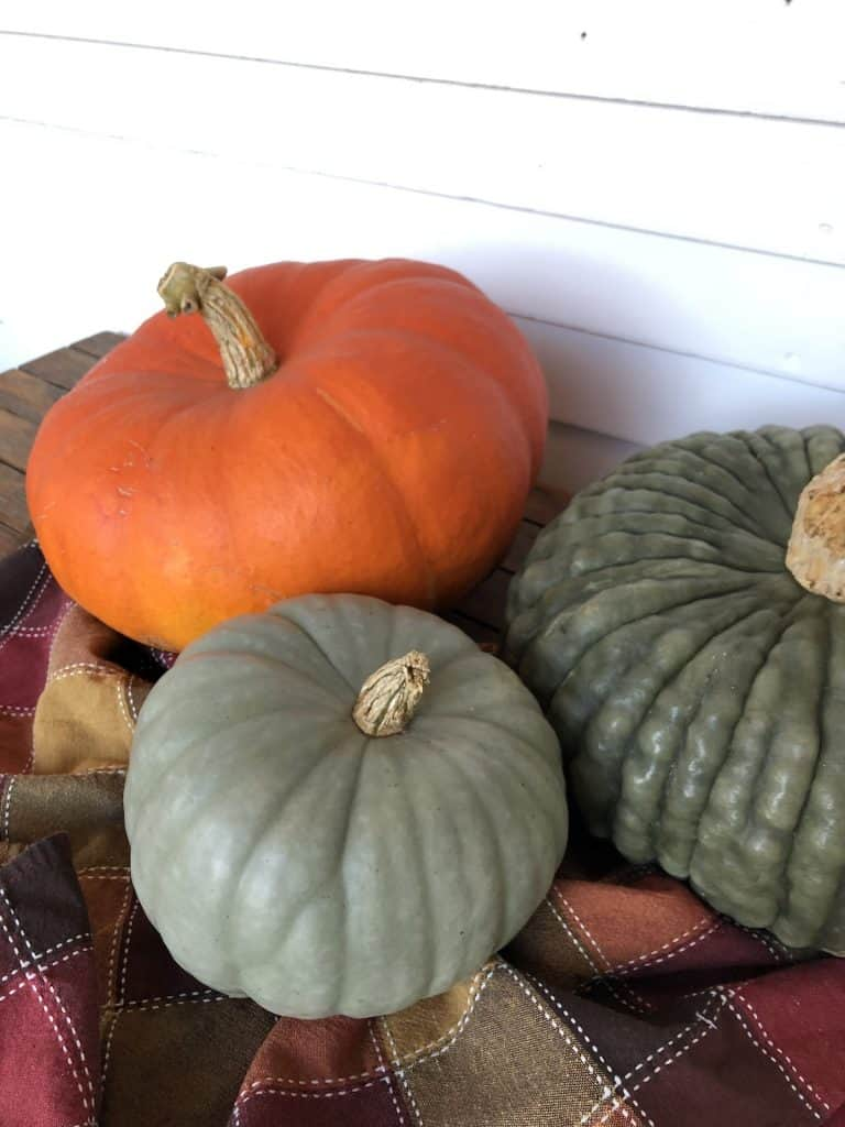 heirloom pumpkins on front porch table