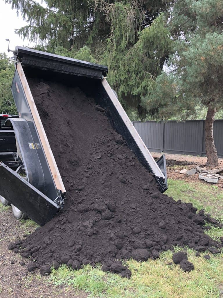 OMRI-listed topsoil being delivered with dump trailer