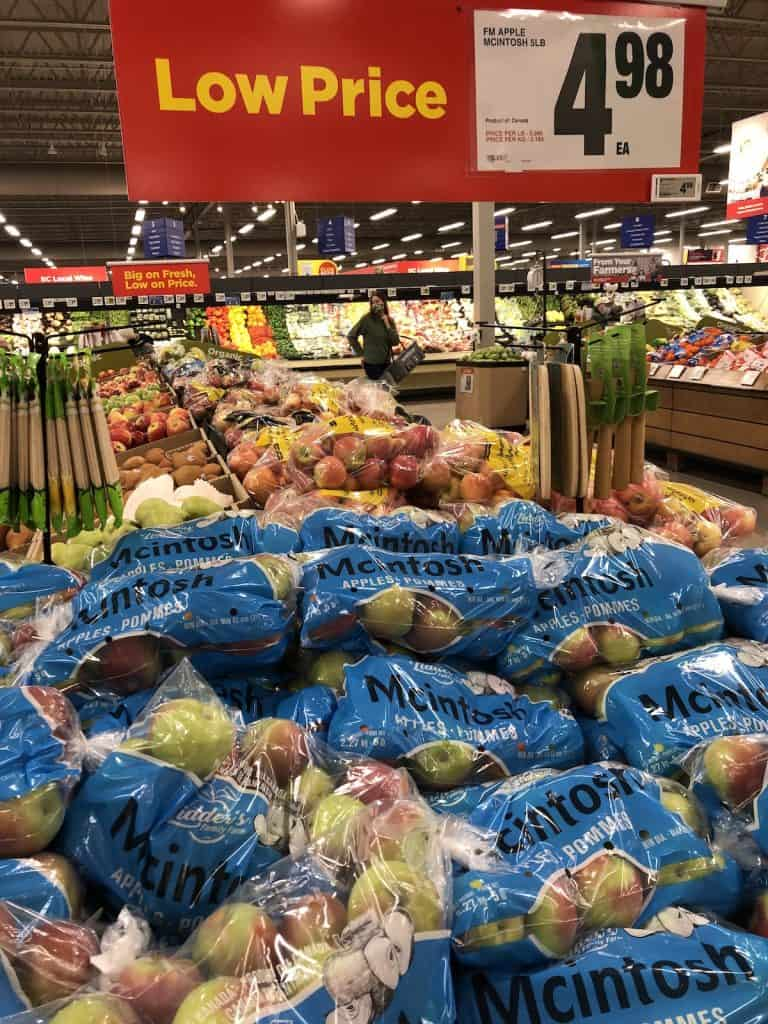 Bags of McIntosh Apples in Autumn at Store