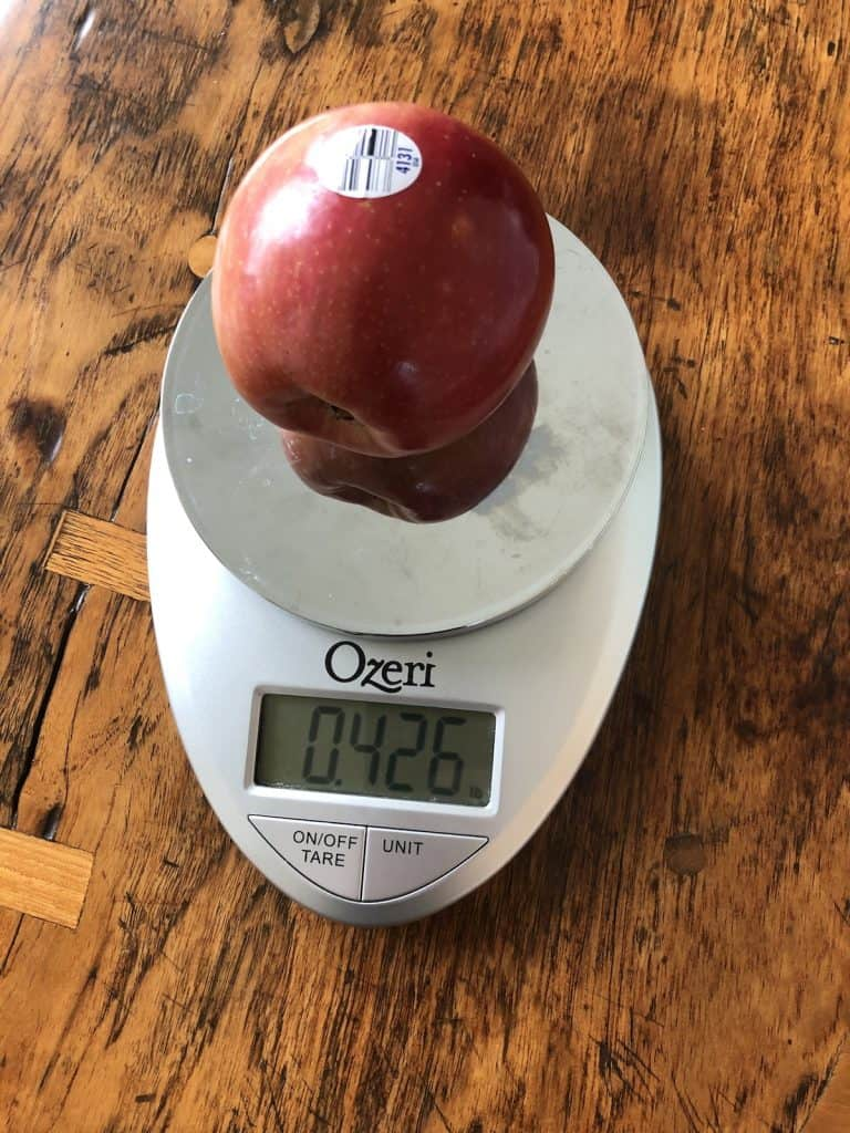 Fuji apple on kitchen weigh scale