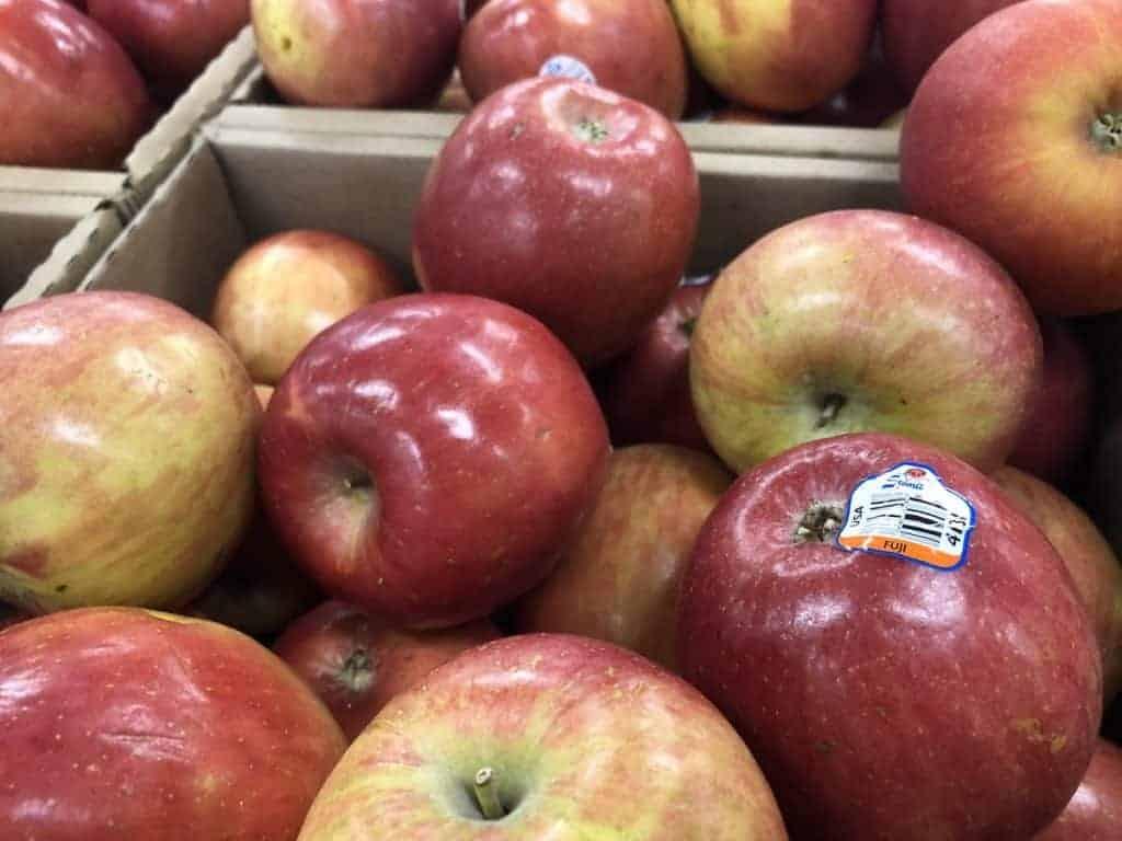 Fuji apples in cardboard bins