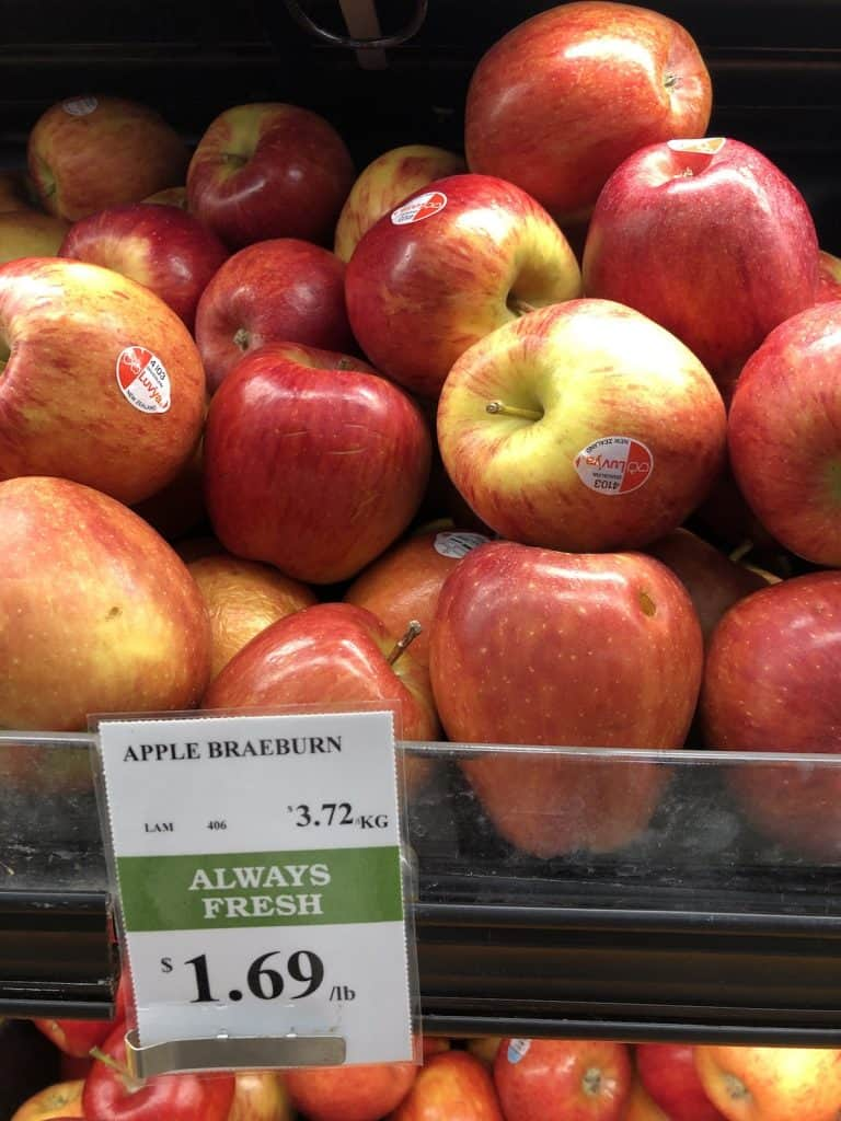 Grocery store self of red Braeburn apples