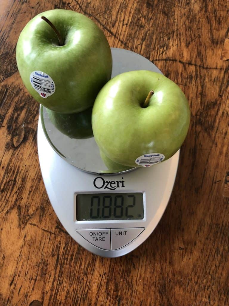 One pound of granny smith apples on weigh scale