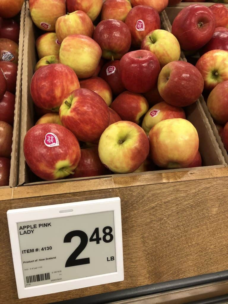 Price tag of $2.48 per lb for pink lady apples at grocery store