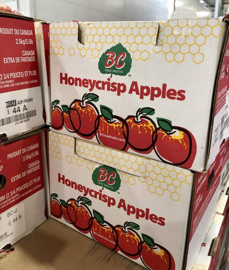 boxes of honeycrisp apples at the store in october