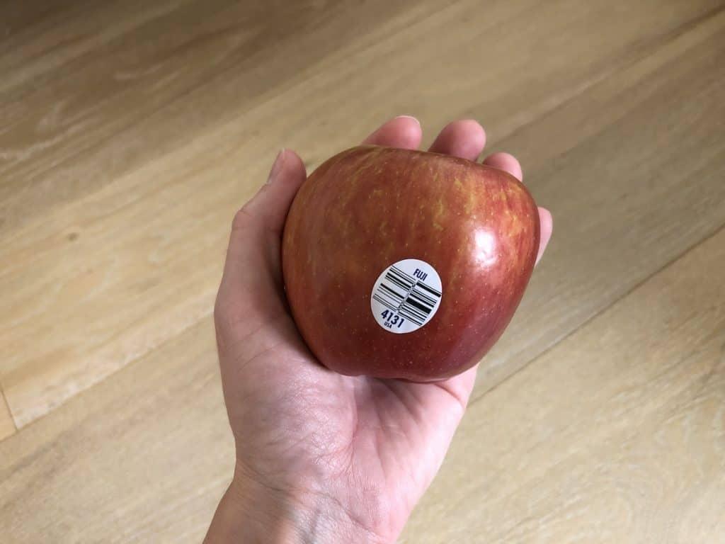 hand holding a fuji apple