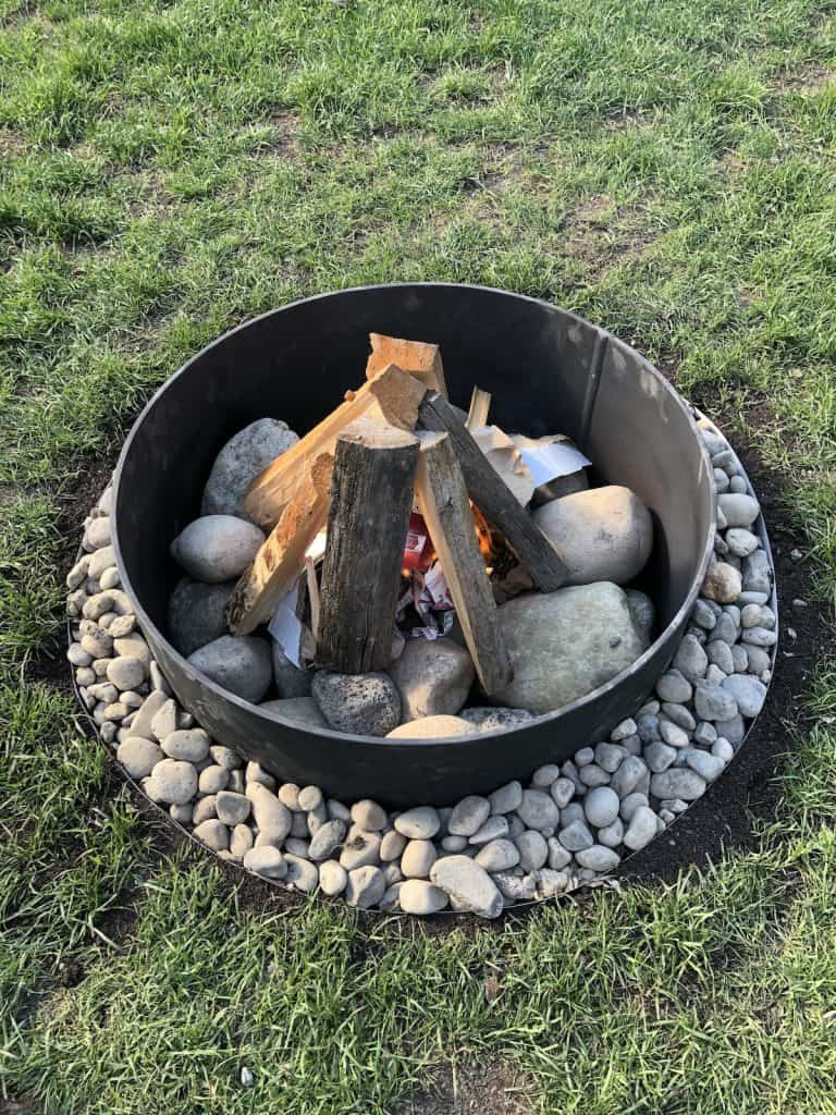 Fire pit with decorative gravel around it