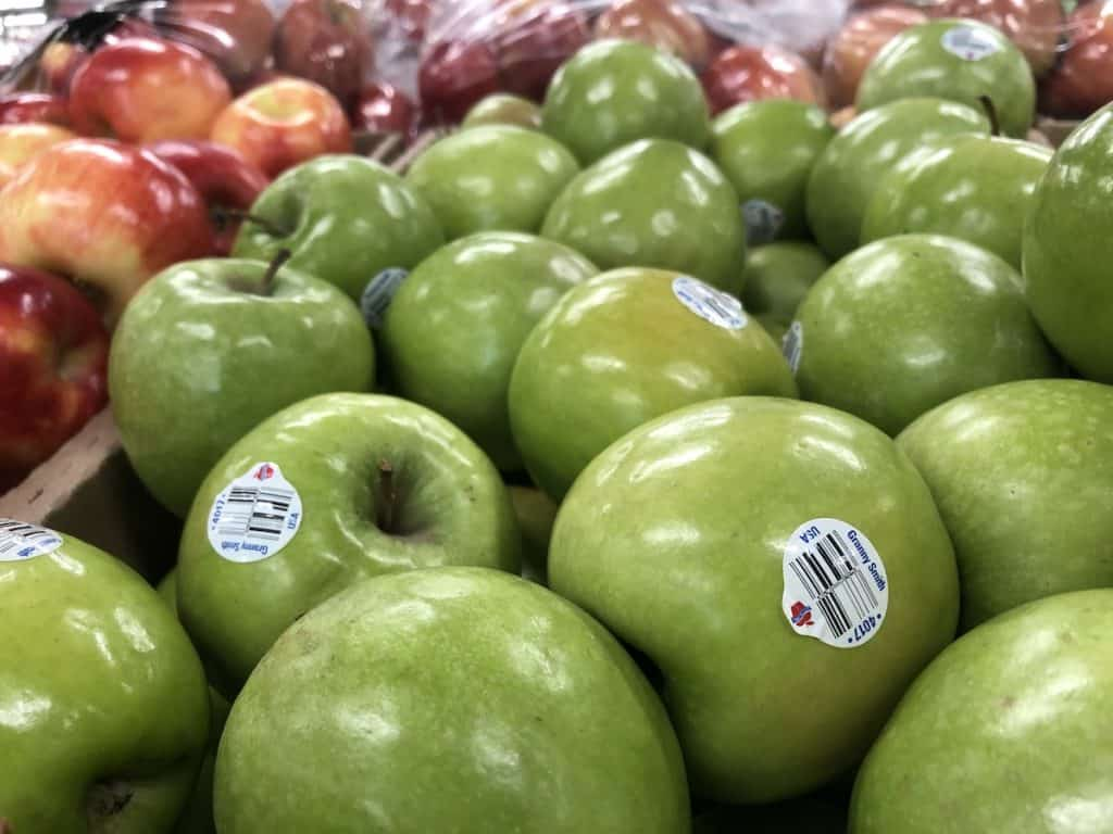 Green Apples in front of Red Apples
