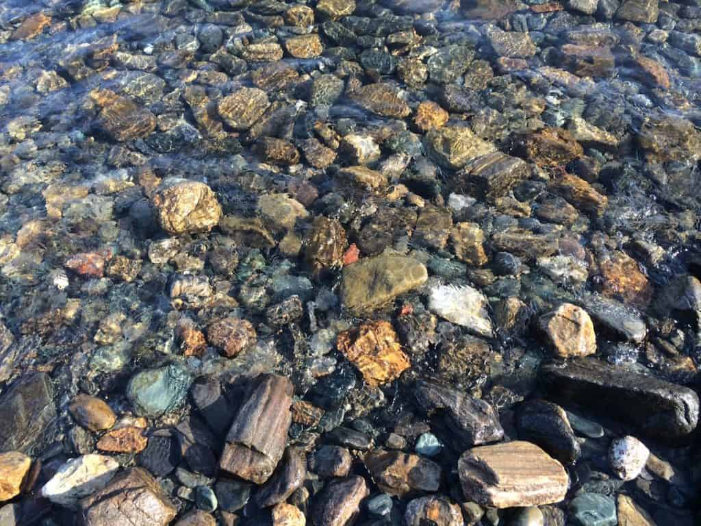 large colourful river gravel in water feature