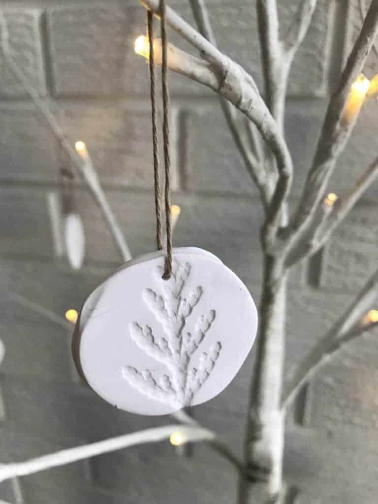 white clay tree ornament with branch